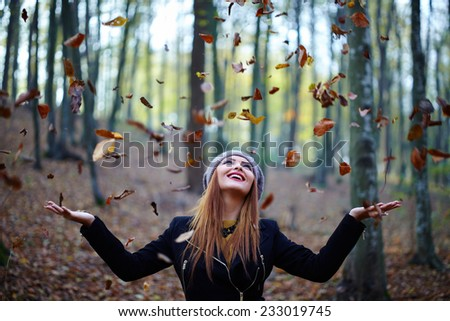Fashionable blonde girl, outdoor portrait in the forest - stock photo