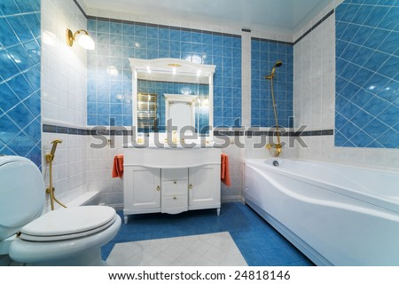 Fashionable blue bathroom in a modern apartment - stock photo