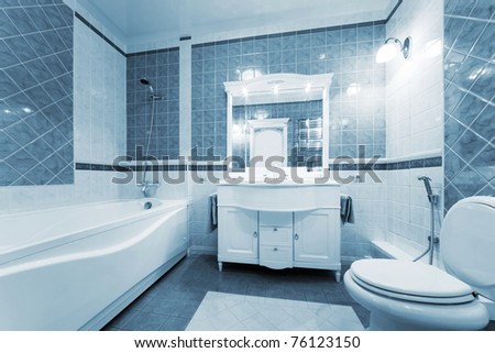 Fashionable blue bathroom in a modern apartment