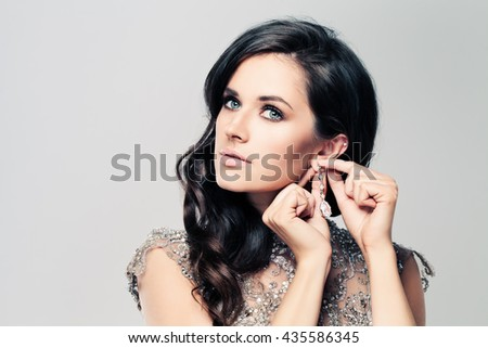 Fashionable Brunette Woman with Diamond Earrings - stock photo