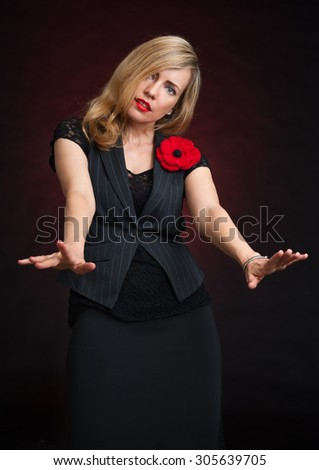fashionable business woman wearing jacket over black background - stock photo