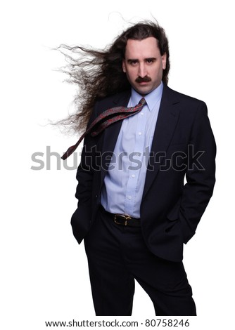 Fashionable businessman with long wind blown hair 1 - stock photo