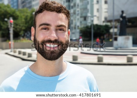 Fashionable caucasian man with beard outdoor in city - stock photo