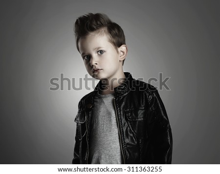 Fashionable child in leather coat.stylish little boy. Autumn fashion.funny 6 years old kid