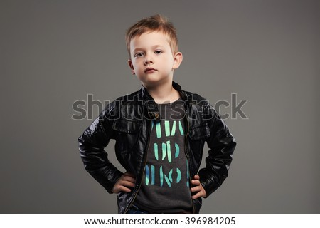 Fashionable child in leather coat.stylish little boy. spring kids fashion - stock photo