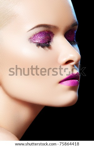 Fashionable close-up portrait of glamour woman model with winter glitter evening make-up, purity complexion. Sensual beauty model with shiny glitter make-up