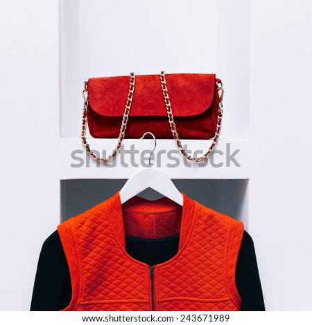 Fashionable Clothing. Black and Red colors in style. Fashion women's accessories. Red clutch bag and jacket. - stock photo