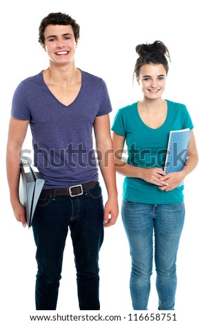 Fashionable college going students posing over white background - stock photo