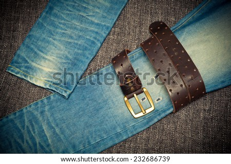 Fashionable concept, jeans and leather belt with buckle - stock photo