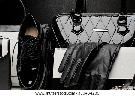 Fashionable female accessories gloves, bags, shoe, Overhead of essentials for stylish young woman - stock photo