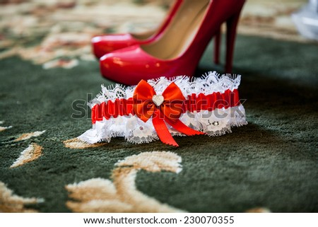 Fashionable female shoes with red loincloth