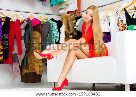 Fashionable girl choosing shoes in a store.