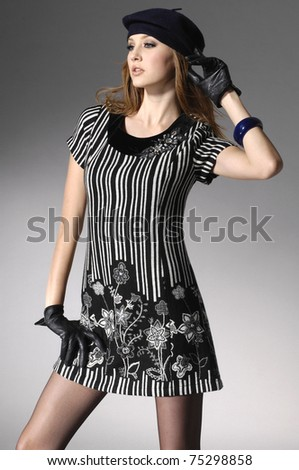 fashionable girl in hat posing in the studio - stock photo