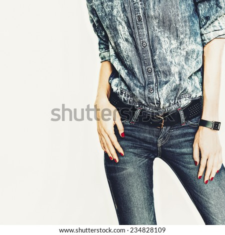 Fashionable Girl in jeans clothes on white background - stock photo