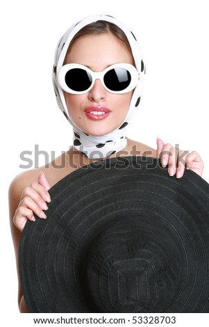 fashionable girl in sunglasses, hides behind a hat - stock photo