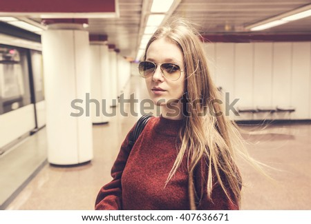 Fashionable girl in the subway - stock photo