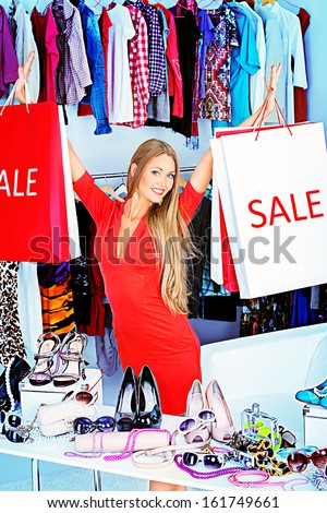 Fashionable girl shopping in a store. - stock photo