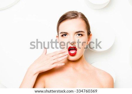 Fashionable girl with red lips  gesturing a surprise