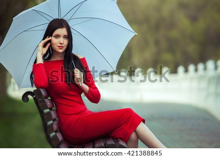 Fashionable girl with umbrella - stock photo