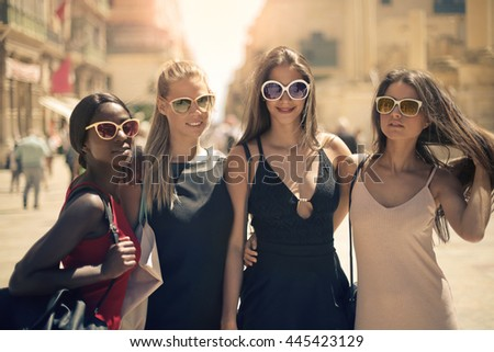 Fashionable girls with sunglasses - stock photo