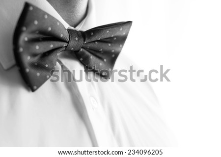 Fashionable groom wearing a bowtie on his wedding day. B&w photo - stock photo