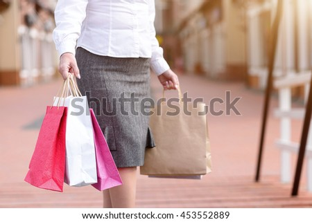 Fashionable lady purchasing in city