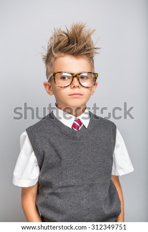Fashionable little boy in sunglasses and funny hairstyle. Stylish kid in suit. Fashion children. Business boy - stock photo