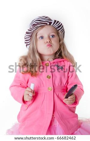 Fashionable little girl sending a kiss - stock photo