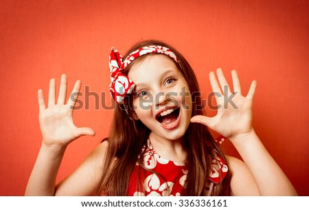 Fashionable little girl showing ten fingers - stock photo