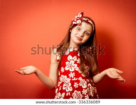 Fashionable little girl throws up his hands - stock photo