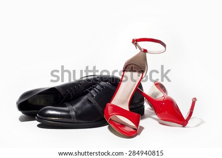 Fashionable male and female shoes isolated on white background - stock photo