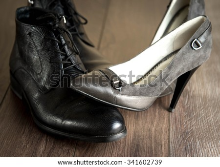 fashionable male and female shoes on a natural background - stock photo