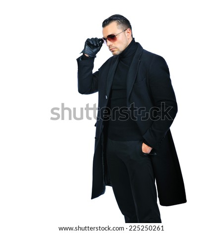 Fashionable man in black coat isolated over white background - stock photo