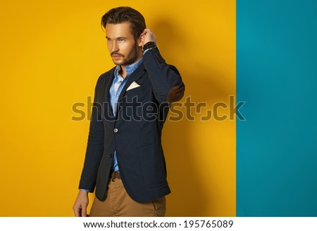 Fashionable man wearing jacket and posing - stock photo