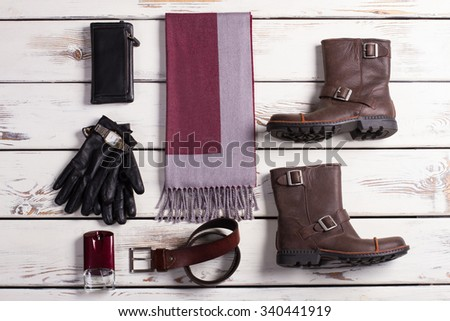 Fashionable men's accessories and shoes on a wooden base. - stock photo