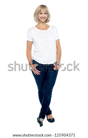 Fashionable middle aged woman posing in style, legs crossed. - stock photo