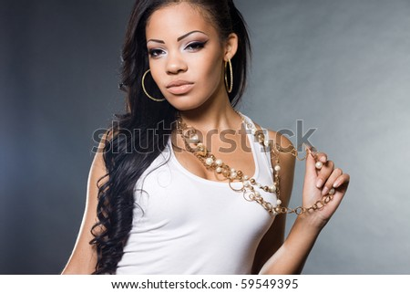 fashionable mulatto woman in a t-shirt - stock photo