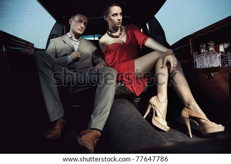 Fashionable pair in a luxury limousine - stock photo
