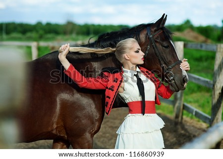 Fashionable portrait of a beautiful young woman whis broune horse - stock photo