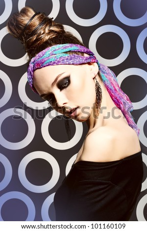 Fashionable portrait of a charming girl wearing a bright headscarf, professional makeup and hairdo - stock photo