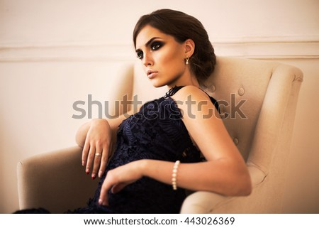Fashionable portrait of a woman in a dark blue dress
