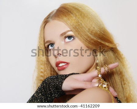 Fashionable portrait of beautiful  girl with long hair. Jewelry and Beauty - stock photo