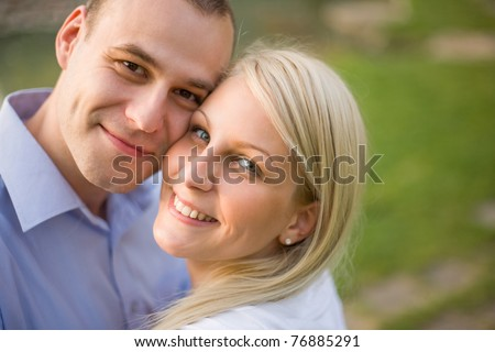 Fashionable romantic young couple outdoors in the park.