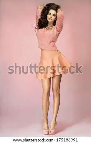 Fashionable sensual brunette woman posing, studio shot. - stock photo