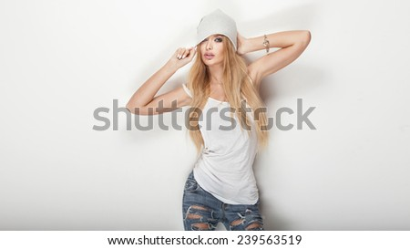 Fashionable sexy blonde woman posing in studio, looking at camera. - stock photo