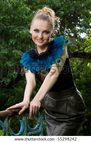 Fashionable smiling chick posing outdoors