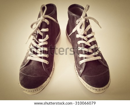 Fashionable sports shoes, teenager fashion, toned image. - stock photo