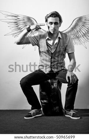 Fashionable stylish man in angel style - stock photo