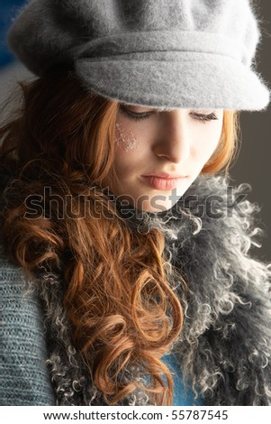 Fashionable Teenage Girl Wearing Cap And Knitwear In Studio - stock photo