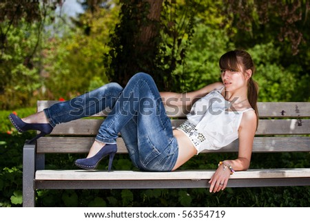 Fashionable teenager girl outside during a summer day in the park. - stock photo